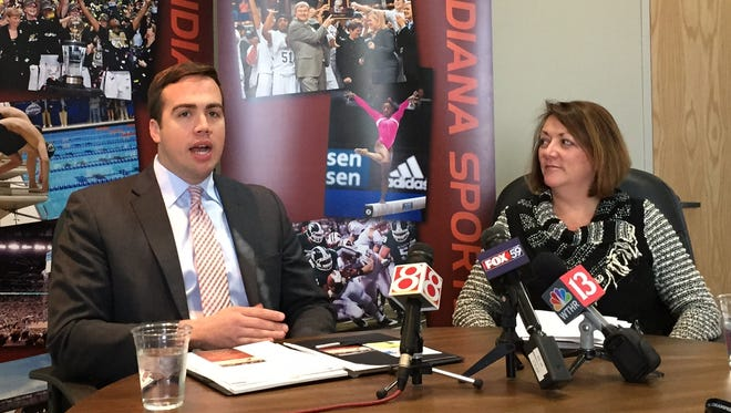 Indiana Sports Corp. president Ryan Vaughn is shown with senior vice president Susan Baughman discussing the College Football Playoff championship game.