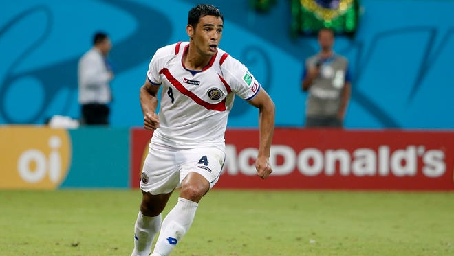 Costa Rica defender Michael Umana reacts to making the wining shot  against Greece at Arena Pernambuco.