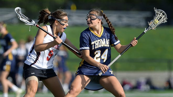 Former Webster Thomas standout Emily Resnick, right, is defended by former Penfield player Mackenzie Maring during a game last May.