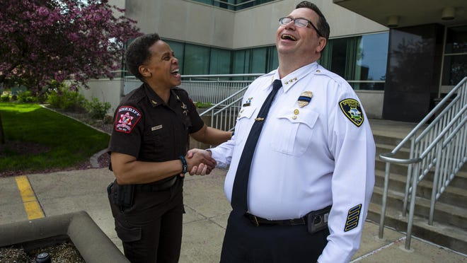 Sangamon County Sheriff's Office Chief Deputy Cheryllynn Williams, left, gives Springfield Chief of Police Kenny Winslow a hard time as she greets him for a press conference on Monday.