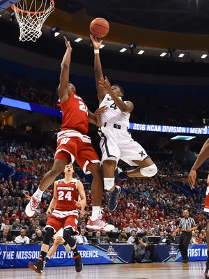 Xavier Musketeers guard Edmond Sumner (4) shoots while guarded by Wisconsin Badgers forward Khalil Iverson (21) during the second half in the second round of the 2016 NCAA tournament at Scottrade Center.