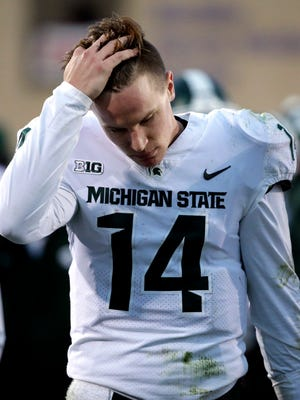 Michigan State quarterback Brian Lewerke reacts on the sideline during the second half of an NCAA college football game against Northwestern in Evanston, Ill., Saturday, Oct. 28, 2017.
