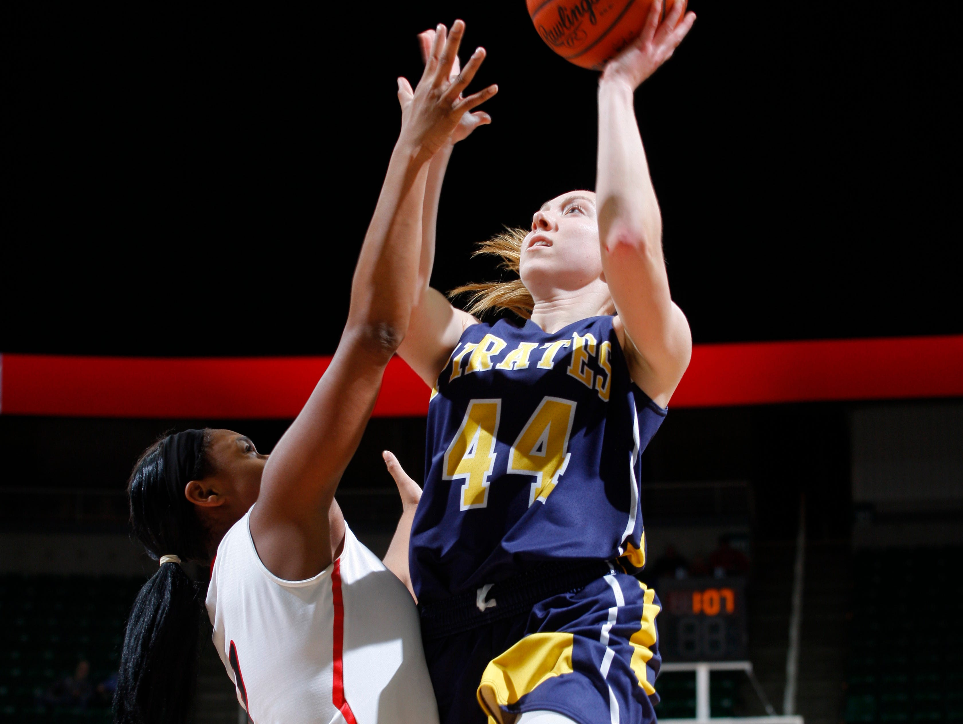 Pewamo-Westphalia's Brenna Wirth (44) goes up for a driving shot against Detroit Edison's Oretha Humphries during their MHSAA Class C championship game, Saturday, March 18, 2017, in East Lansing, Mich. P-W fell 46-44.