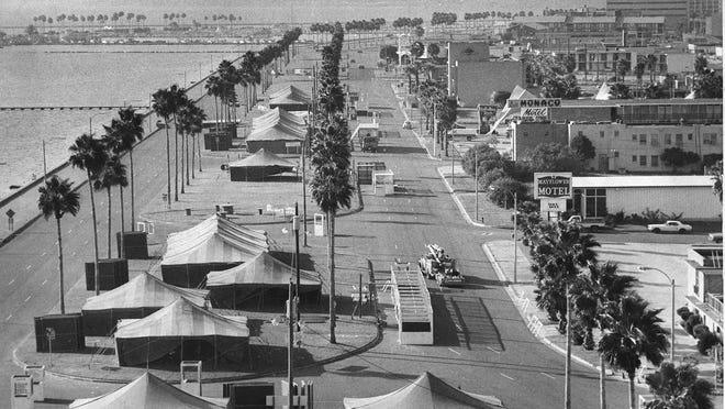 Crews set up the tents for the first Bayfest on Sept. 30, 1976. The three-day festival was held on Shoreline Boulevard where North Bayfront Park and the American Bank Center Arena currently stand.