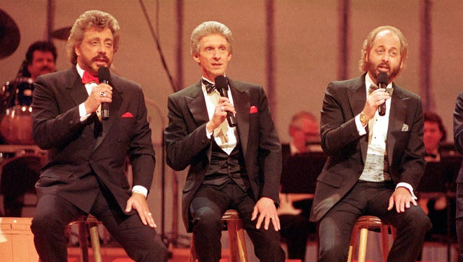 The Statler Brothers, from left, Harold Reid, Phil Balsley, Don Reid, and Jimmy Fortune. perform in Nashville in this 1992 photo. Below, coverage of the group's final concert in The News Leader in October 2002.