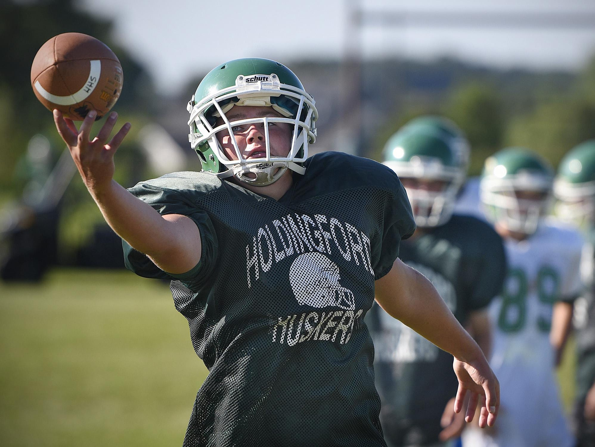 Holdingford players complete a passing drill during practice Wednesday in Holdingford.