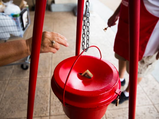 David Deciantis, a Salvation Army bell ringer, rings his bell as a Publix shopper adds money to the bucket on Monday, Nov. 28, 2016, at Publix at Kings Lake Square in East Naples. The Red Kettle Christmas Campaign provides food, clothing and toys to families in need during the holiday season.