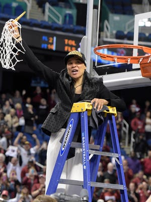 South Carolina head coach Dawn Staley cuts down the net after her team defeated Florida State 80-74 to win their NCAA Women's Regional Tournament Sunday, March 29, 2015 at the Greensboro Coliseum in Greensboro, N.C.