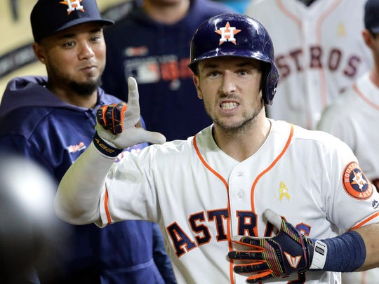 Houston Astros' Alex Bregman celebrates in the dugout after hitting a home run against the Seattle Mariners during the sixth inning of a baseball game Saturday, Sept. 7, 2019, in Houston. (AP Photo/David J. Phillip)