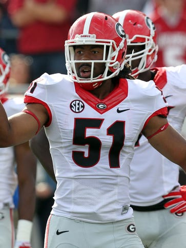 Georgia linebacker Ramik Wilson motions to the sideline