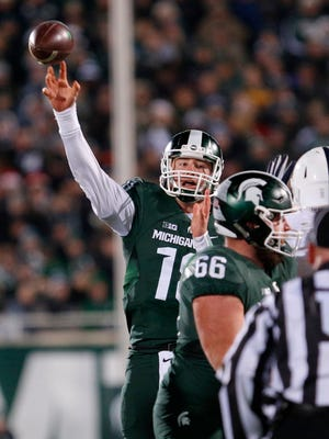 Connor Cook led Michigan State past Iowa to start his Big Ten career. He hopes to do it again Saturday for the Big Ten title.