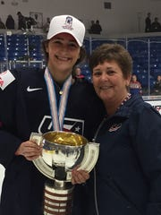 Shortly after winning the women's world championship last April in Plymouth, USA defender and North Farmington graduate Megan Keller poses with her mother Lynn.
