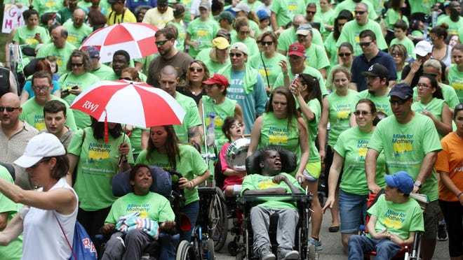 Participants take to the streets at the start of the Lu Huggins Wheelchair Walk at the 18th annual Miles for Matheny fundraiser, Sunday, in Peapack & Gladstone, NJ.