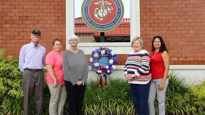 "Master Gunnery Sgt Lawrence Crane, USMC (Ret.), Andria Davis, Sandra Crane, Rachel Painter and Carol Hurst Long, members Jacksonville-Onslow Civic Affairs Committee, stand alongside a wreath laid at the Freedom Fountain in Jacksonville paying tribute to Sgt. Wolfgang ""Wolf"" K. Weninger who died while conducting airborne training on 16 June 2020.  Master Gunnery Sgt Lawrence Crane, USMC (Ret.) placed his jump wings on the memorial wreath."