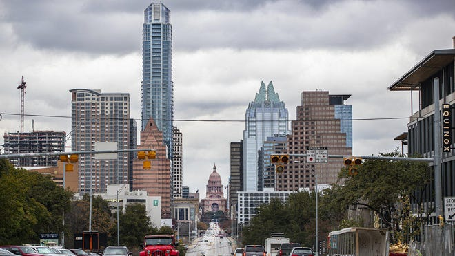 Clouds move in slowly at over downtown Audtin on Thursday, Jan.9, 2020. According to the AccuWeather  A severe afternoon t-storm; storms can bring downpours, large hail, damaging winds, and a tornado into the Central Texas on Friday, Jan. 10, 2020.