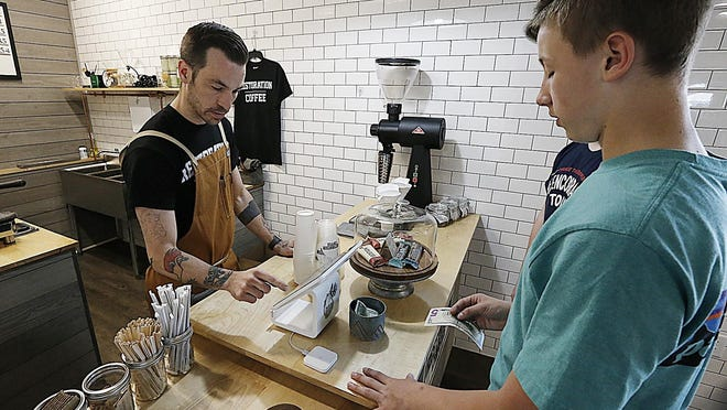 Matt Wood makes and ice tea for Nolan Clack,16, of Whitman as he waits to get a haircut on Tuesday,May 8, 2018. Dave DeMelia/The Enterprise file photo
