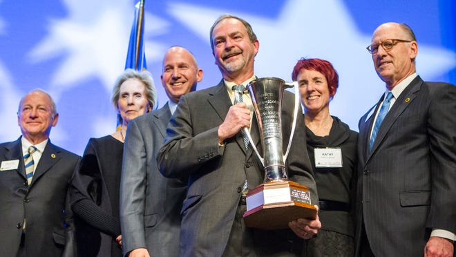 Dr. Robert Laskowski holds up the Josiah Marvel Cup after giving his acceptance speech at the Delaware Chamber of Commerce's annual dinner at the chase Center on the Riverfront in Wilmington in 2014.