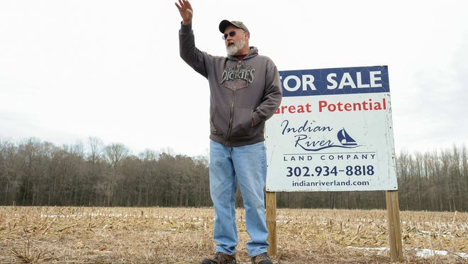 Millsboro-area resident Richard Eaton doesn't want to the land behind him, at Revel Road and Indiantown Road near Millsboro, sold to Mountaire Farms.