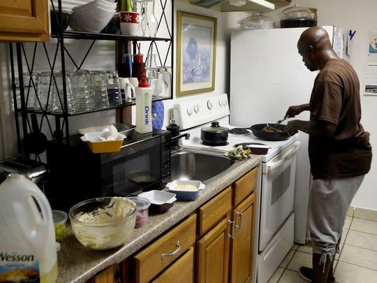 Alonzo Scott makes food for a friend's birthday Thursday