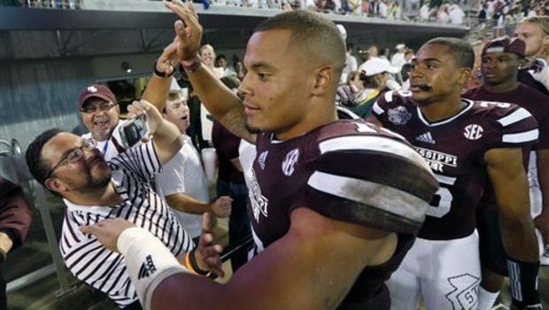 Mississippi State quarterback interacts with fans after the Bulldogs' season-opening win of 2014.