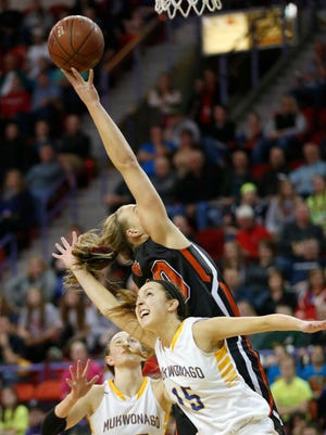 Mukwonago's Amanda Brown (15) and Verona's Grace Mueller battle for a rebound during the first half of their WIAA Division 1 state basketball championship game.