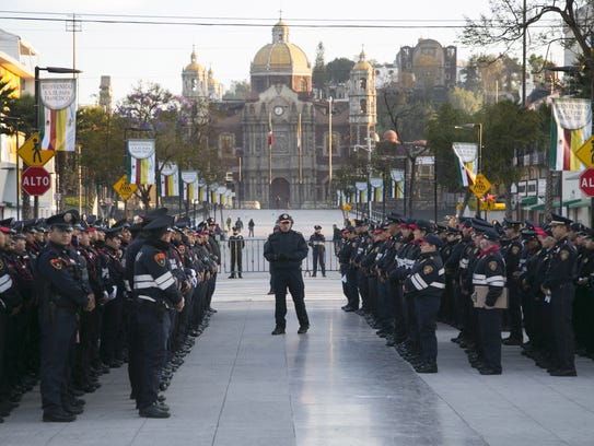 Local police line up for a briefing in front of the