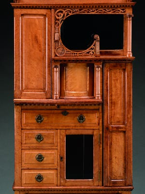 This strange cabinet was made in the 19th century to display many small, unusual items, known then as curiosities. It auctioned for $1,936.