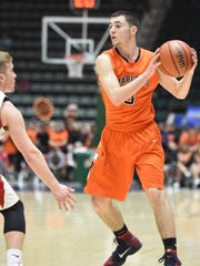 Marlboro High School's Tyler Jollie looks to make a move against Olean on Saturday in Glens Falls.