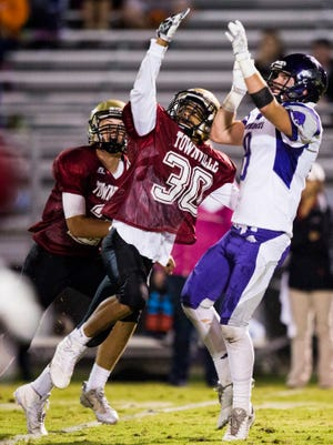 PendletonÕs Jason Wright (30) blocks a pass intended for Walhalla sophomore Patrick Nations during the Pendleton vs. Walhalla football game on Friday, October 7, 2016 in Pendleton.