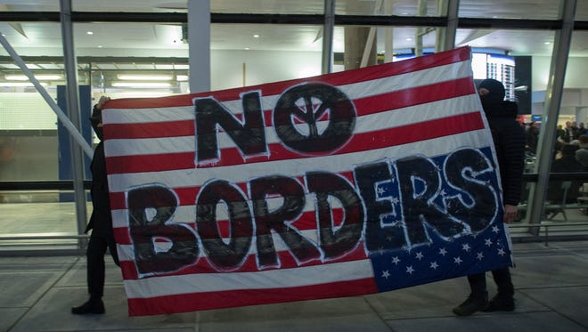 President Trump has signed a sweeping executive order to suspend refugee arrivals and impose tough controls on travelers from seven Muslim countries, inspiring protests at New York's JFK International Airport.