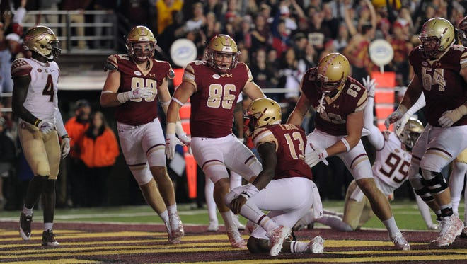 Boston College Eagles quarterback Anthony Brown (13) scores a touchdown during the first half against the Florida State Seminoles at Alumni Stadium.