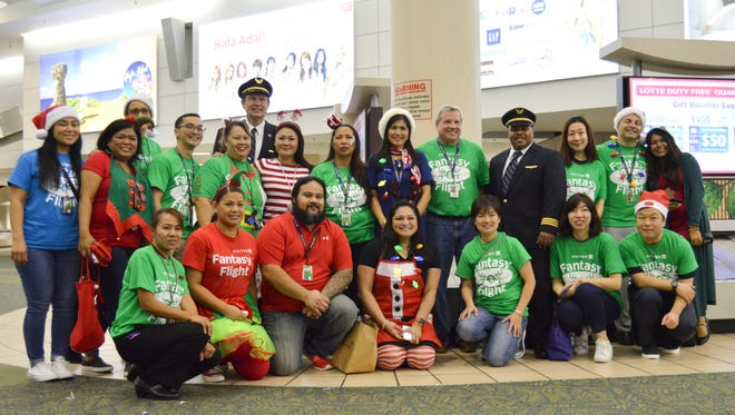 United Airlines: United Airlines' employees and volunteers pose for a photo during United Airlines' fourth annual Fantasy Flight event on Dec. 8, 2017.
