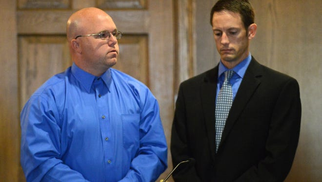 Christopher B. Bayer II, left, stands next to his attorney Shawn Dominy as Bayer speaks to Franki Nutter the daughter of Mary Nutter Thursday in Fairfield County Common Pleas Court in Lancaster. Bayer was sentenced to four years in prison for hitting and killing Mary Nutter with a vehicle.