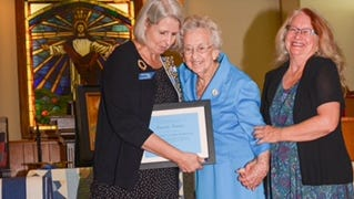 TSDAR State Historian Linda Moss Mines presents the inaugural Treasure Award to Margaret Clark Norville, 92, of the Cypress Community in Crockett County. Norville is escorted by her daughter Carol Berning.