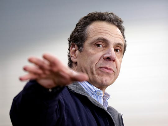 New York Gov. Andrew Cuomo speaks at an event back