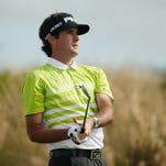 Bubba Watson of the United States watches his tee shot on the second hole during the third round of the Hero World Challenge.