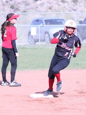 Cobre's Valerie Torres rounds second base en route to snagging her first of two triples Tuesday evening at Tom Powers Field in Bayard.
