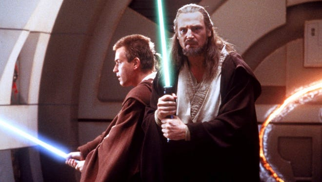 """Ewan McGregor, left, and Liam Neeson, who star in """"Star Wars: Episode 1 _ The Phantom Menace,"""" are pictured in this still image from the movie.   NY139"""