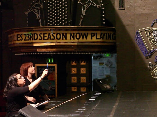 Stage Manager Emma Latimer, 24, (left) and Assistant Stage Manager Niki Beach, 24, looks over the stage before the show at the Palm Springs Follies on Thursday, May 1, 2014 in Palm Springs, Calif.