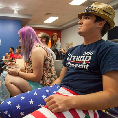 Students watch the first presidential debate at the