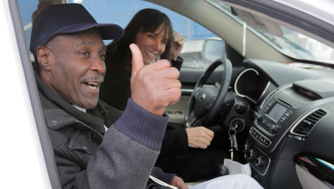 Stanley Wrice, left, convicted of rape and sentenced to 100 years in prison in 1982, gives a thumbs-up sign as he and his attorney Jennifer Bonjean, leave Pontiac Correctional Center on Dec. 11, 2013 in Pontiac, Ill.