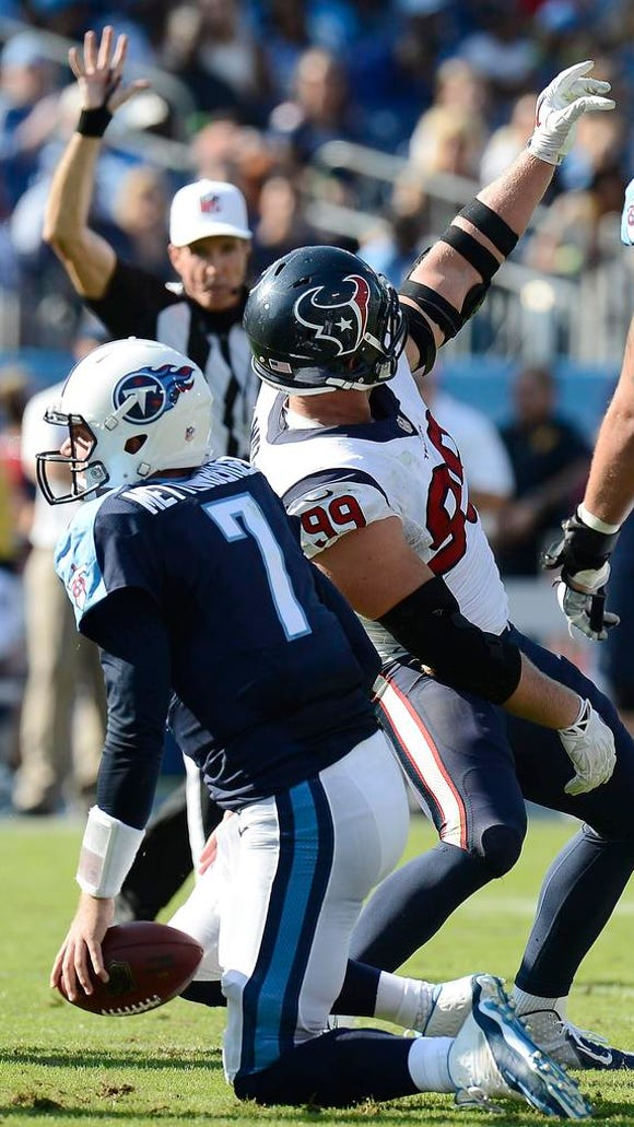 Texans defensive end J.J. Watt pretends to take a selfie after sacking Titans quarterback Zach Mettenberger in the fourth quarter.