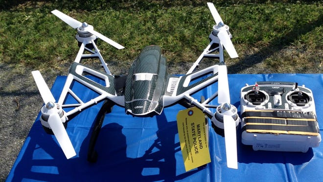 A Yuneec Typhoon drone and controller are pictured Aug. 24, 2015, in Jessup, Md., where Maryland State Police and prison officials say two men planned to use the drone to smuggle drugs, tobacco and pornography videos into the maximum-security Western Correctional Institution.