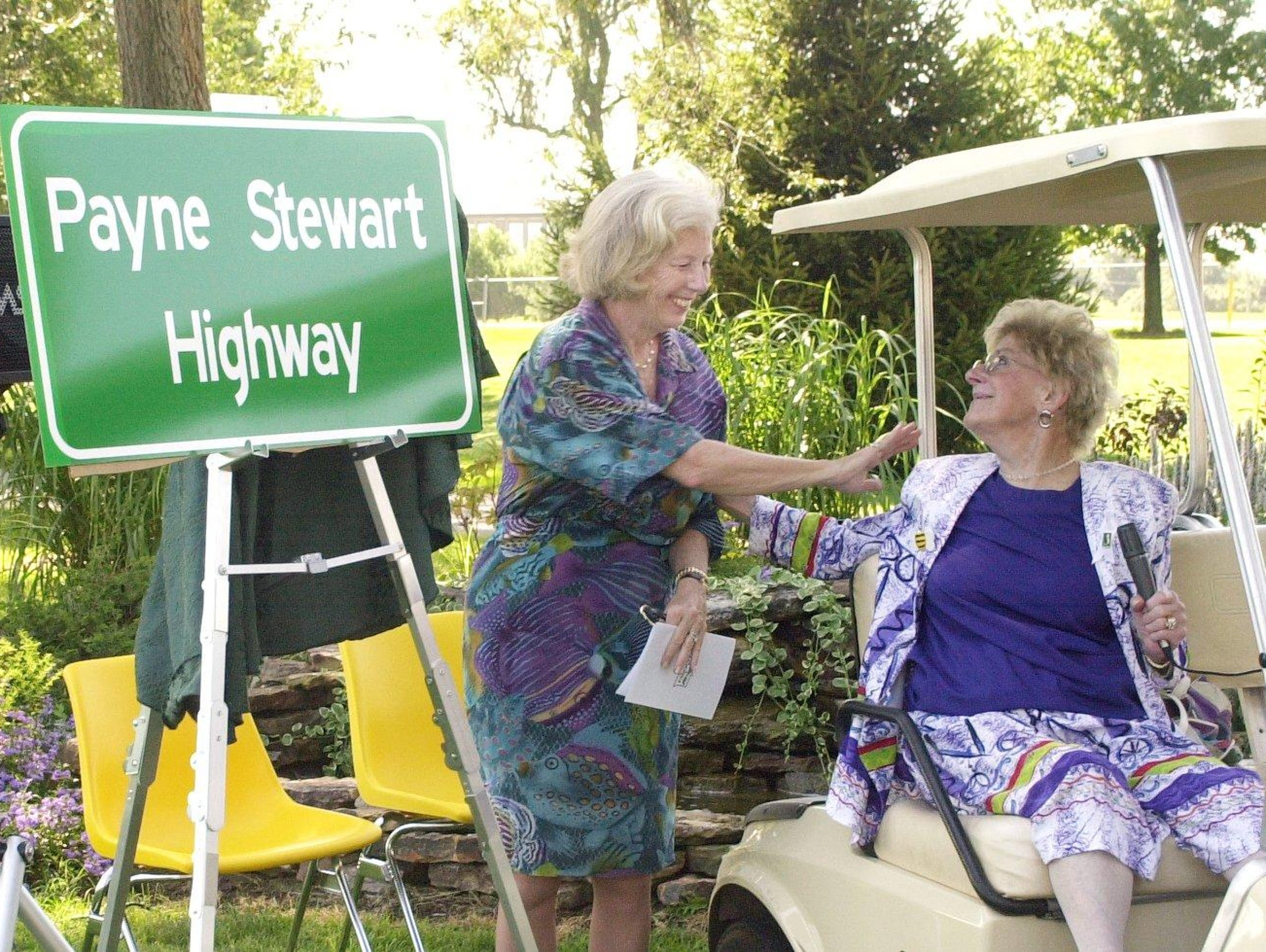 Late golfer Payne Stewart's mother Bee Stewart, right,