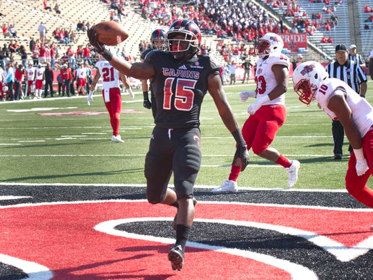 UL senior running back Elijah McGuire scores against Arkansas State earlier this season.