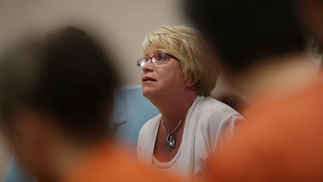 Jacque Sytsma, mother of Craig Sytsma who was mauled to death by dogs belonging to Valbona Lucaj, 45, left and Sebastiano Quagliata, 46, right speaks in front of the court about her loss during Lucaj and Quagliata's sentencing in Lapeer County Circuit Court on Tuesday, July 14, 2015. The pair were breeding Cane Corsos, large mastiff-like dogs, at their home on Thomas Road in rural Metamora last July when jogger Craig Sytsma, 46, ran past. The 100-pound dogs dragged him into a ditch, and mauled him to death as frantic neighbors tried to chase them off.