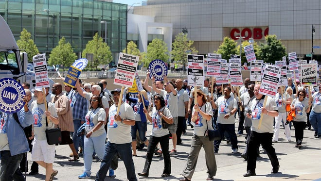 Over 1000 delegates and other labor leaders attending the 36th 2014 UAW Constitutional Convention at Cobo Center in Detroit joined the newly elected UAW president Dennis Williams in a rally in support of hospitality workers at the Crowne Plaza in Detroit on Thursday, June 05, 2014.Jessica J. Trevino/Detroit Free Press