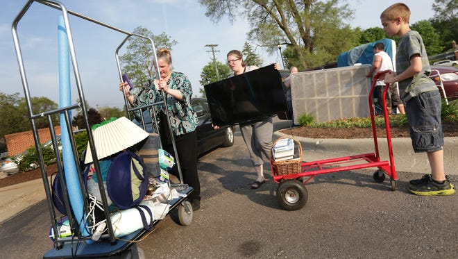Linda Thomas, from left her daughter Anne Amodeo and grand son Dale Hatcher, 10, are moving Thomas' mother's belongings into Arden Courts after the Bureau of Community and Health Systems suspended abruptly Ashley Court of Livonia's nursing home license in Livonia on Monday, May 23, 2016.