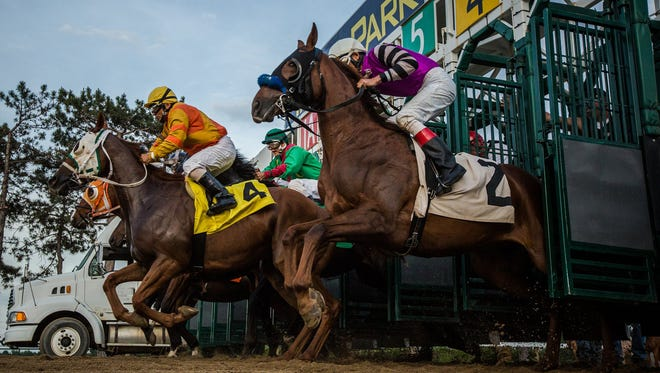 Horses race during the 2016 opening day at Hazel Park Raceway on Friday, May 27, 2016, in Hazel Park. Hazel Park Raceway announced it is closing, effective April 5, 2018, after nearly 70 years of horse racing.