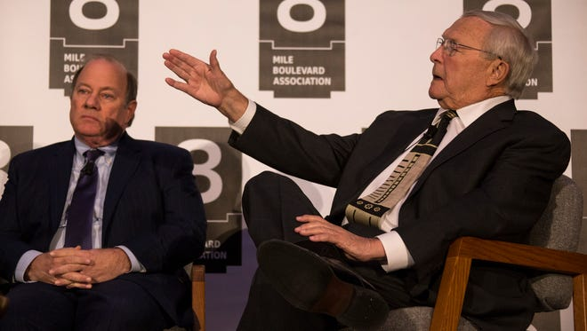Detroit Mayor Mike Duggan, left, listens as Oakland County Executive L. Brooks Patterson makes his point about regional transit Friday April 20, 2018 during a luncheon at Cobo Center in Detroit hosted by the 8 Mile Boulevard Association's annual leadership luncheon.